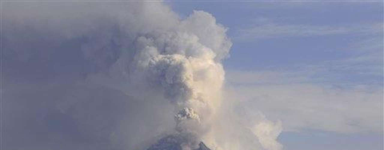 Ecuador has suspended school in four towns near the Tunguarahua volcano as ash spews 2 1/2 miles (4 kilometers) into the sky, damaging crops and endangering the health of nearby residents.Authorities are urging people to cover their mouths and noses with masks and shut windows amid the furious venting of Tunguarahua that began Monday.The state Geophysical Institute said Tuesday that lava is flowing from the summit caldera down the flanks of the 16,480-foot (5,023-meter) peak. The volcano is 85 miles (135 kilometers) southeast of Quito.The Education Ministry says classes in the nearby towns will be suspended at least through Wednesday.Tunguarahua has been active since 1999. Its eruptions killed at least four people in 2006.
