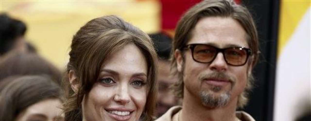 Cast member Angelina Jolie, left, and Brad Pitt arrive at the premiere of \