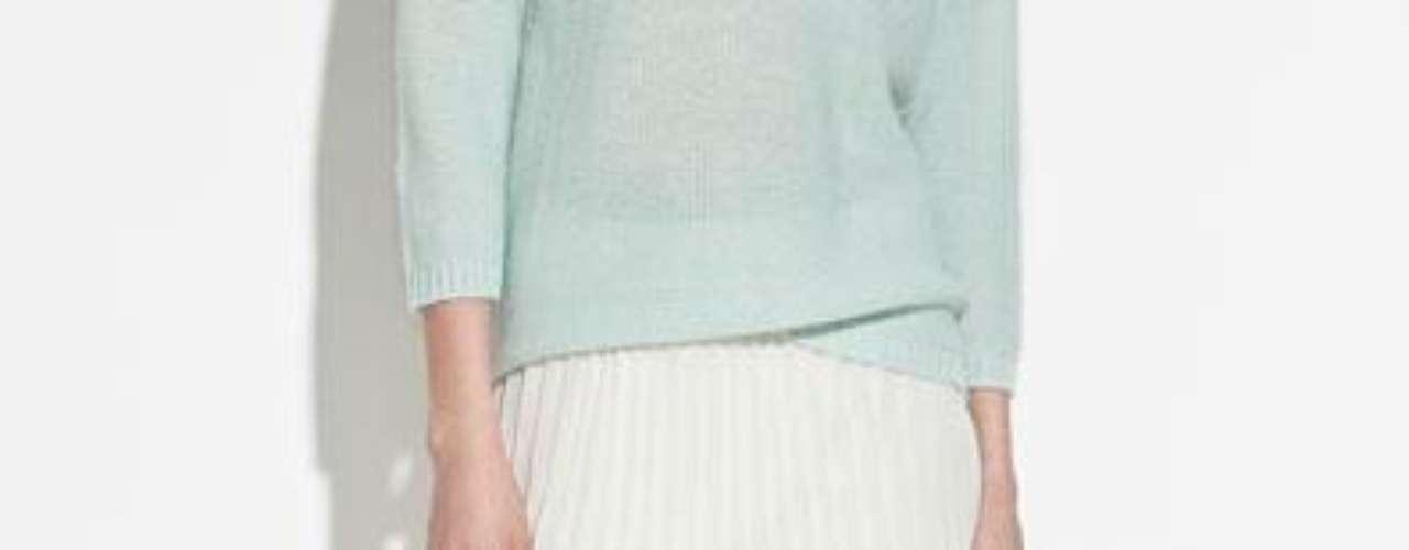 Falda plisada de largo asimétrico  en blanco y varios colores más a 49,90 USD en Zara
