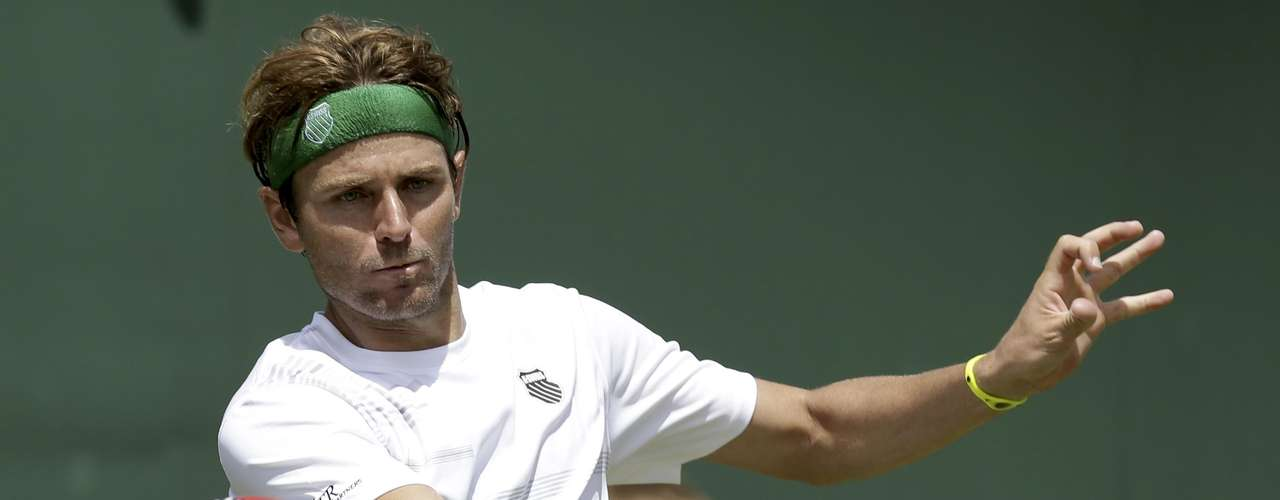 Mardy Fish of the United States returns a shot to Ruben Ramirez Hidalgo of Spain during a first round men's singles match at the All England Lawn Tennis Championships at Wimbledon, England, Tuesday, June 26, 2012. (AP Photo/Sang Tan)