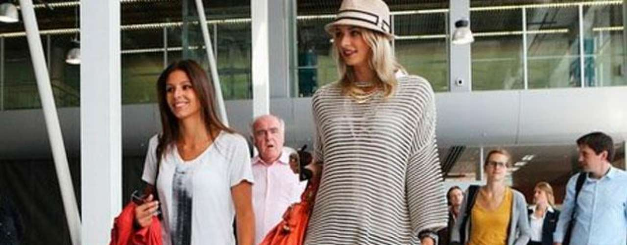 Model Lena Gercke, the girlfriend of German soccer star Sami Khedira, has drawn too much negative attention for her outfits, and the German Federation has warned her to stop dressing so provocatively.