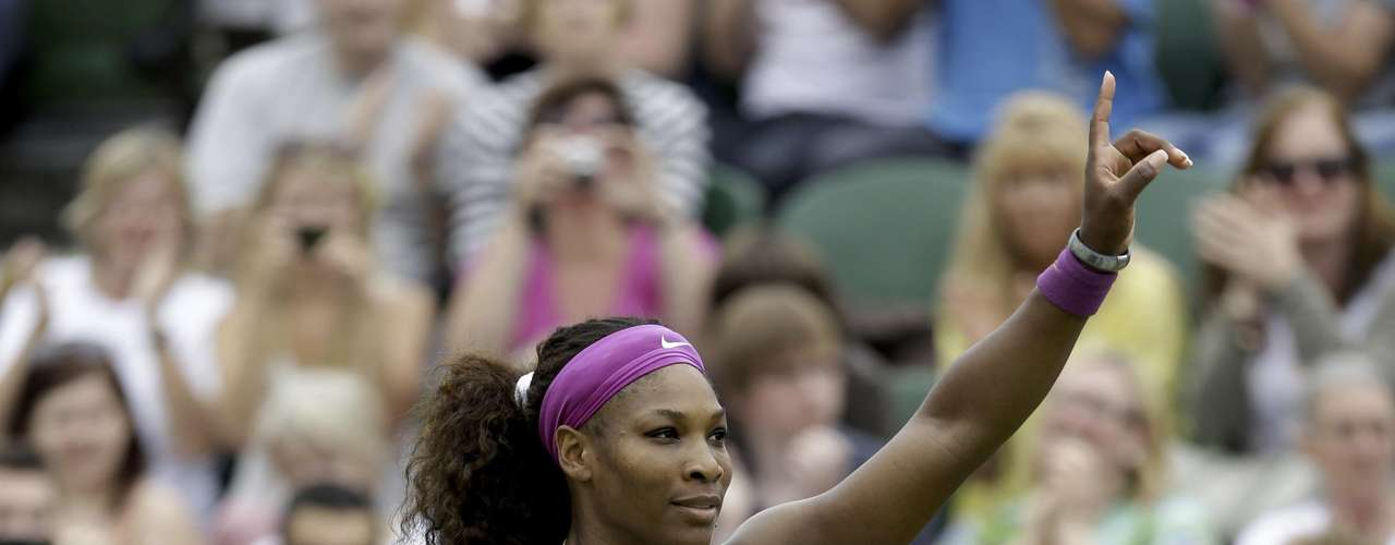 Serena Williams of the United States gestures after defeating Barbora Zahlavova Strycova of the Czech Republic during a first round women's singles match at the All England Lawn Tennis Championships at Wimbledon, England, Tuesday, June 26, 2012. (AP Photo/Alastair Grant)