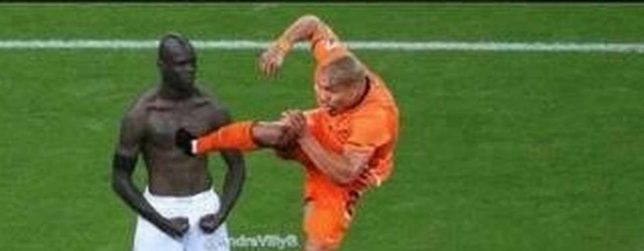 The Italian striker is immune to everything, including the Nigel De Jong karate kick.