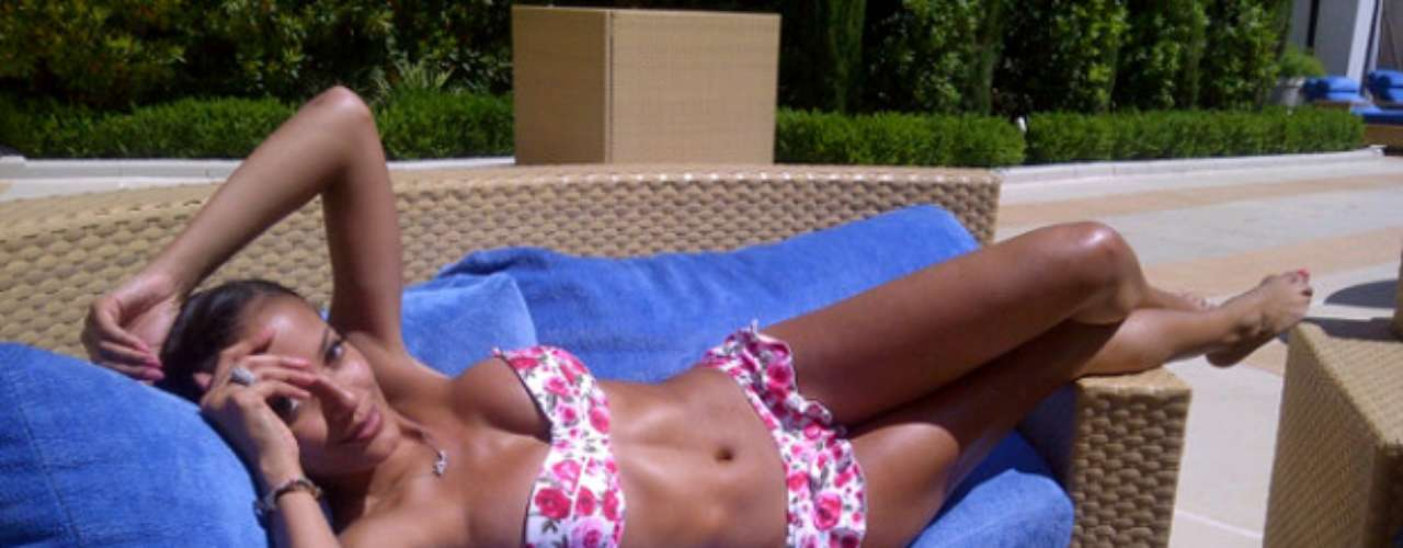 Don't you wish you were the furniture Selita Ebanks is relaxing on?!