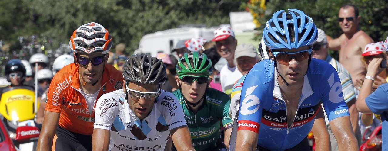 Garmin-Sharp rider David Millar of Britain, Team Europcar rider Cyril Gautier of France, AG2R La Mondiale rider Jean Christophe Peraud of France and Euskaltel-Euskadi rider Egoi Martinez of Spain cycle in a break away during the 12th stage of the 99th Tour de France .