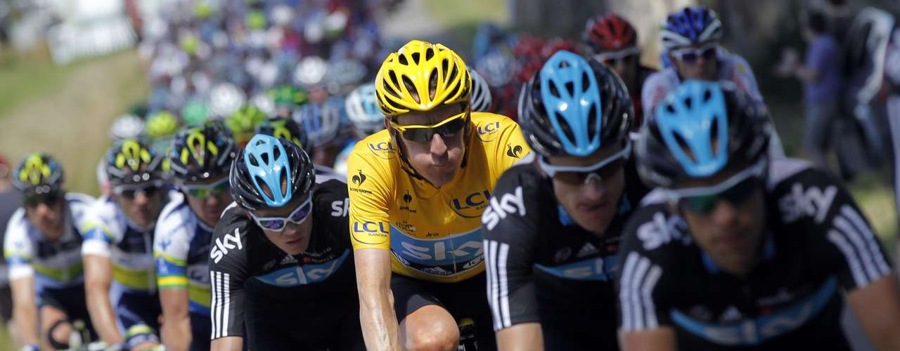 Wiggins (C) of Britain cycles with team mates during the 12th stage of the 99th Tour de France.