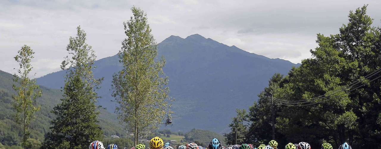 The pack of riders cycles during the 12th stage of the 99th Tour de France cycling race between Saint-Jean-de-Maurienne and Annonay-Davezieux, July 13, 2012.