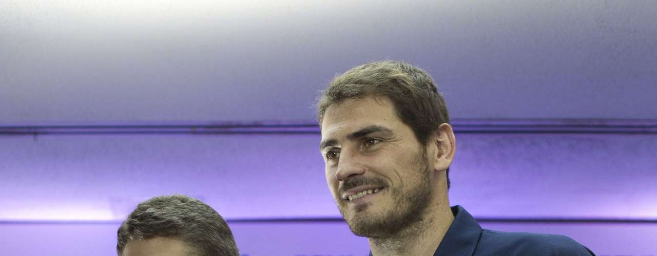 Spain's national soccer team captain Iker Casillas (R) poses next to a young fan with special needs, who wears his signed jersey, after a news conference in Caracas July 16, 2012. Casillas was in Venezuela to attend a coaching clinic for children in Caracas. REUTERS/Carlos Garcia Rawlins (VENEZUELA - Tags: SPORT SOCCER)