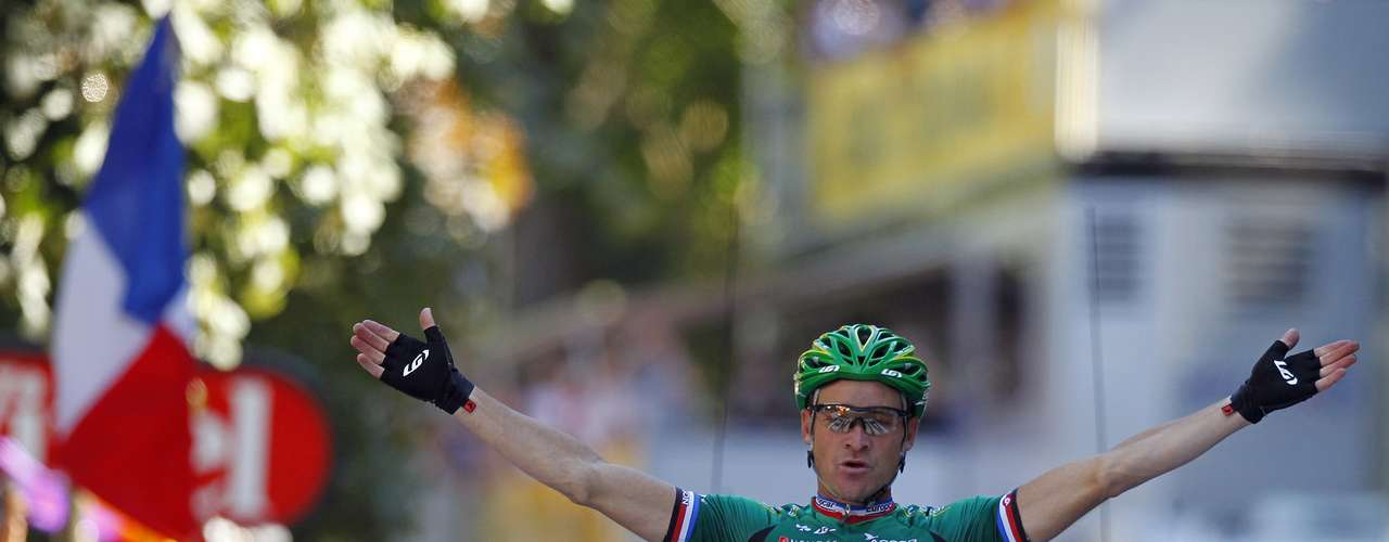 Team Europcar rider Thomas Voeckler of France holds up his arms as he wins the 16th stage of the 99th Tour de France.