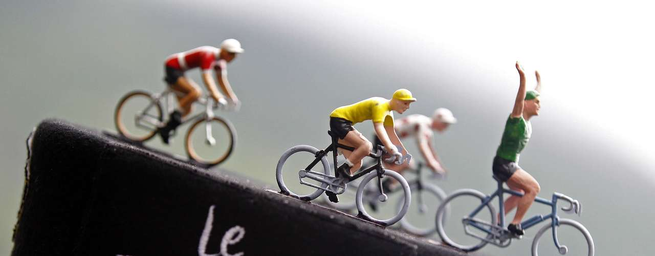Toys figurines representing the leader's jersey riders are seen on a hat before the start of the 17th stage.