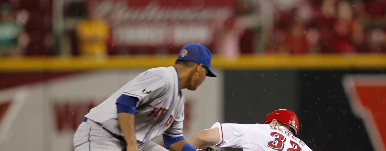 Cincinnati Reds' Jay Bruce slides in safe under the tag of New York Mets shortstop Ruben Tejada.