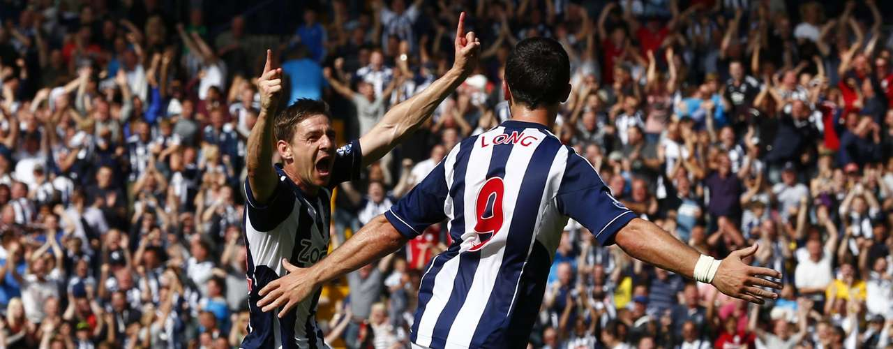 West Bromwich Albion's Zoltan Gera (L) celebrates his goal against Liverpool.
