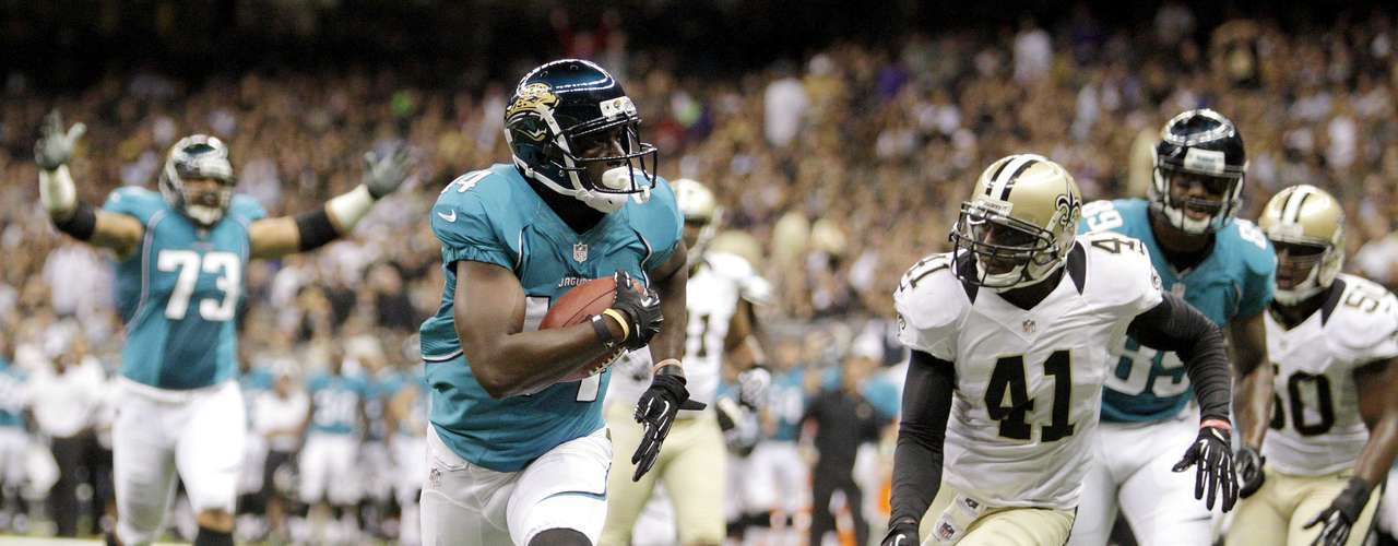 Jacksonville Jaguars wide receiver Justin Blackmon (2nd L) scores a touchdown against the New Orleans Saints.