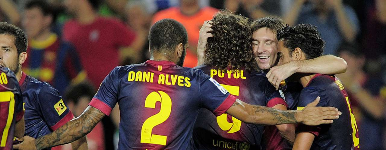 Teammates congratulate Messi after scoring Barca's second goal