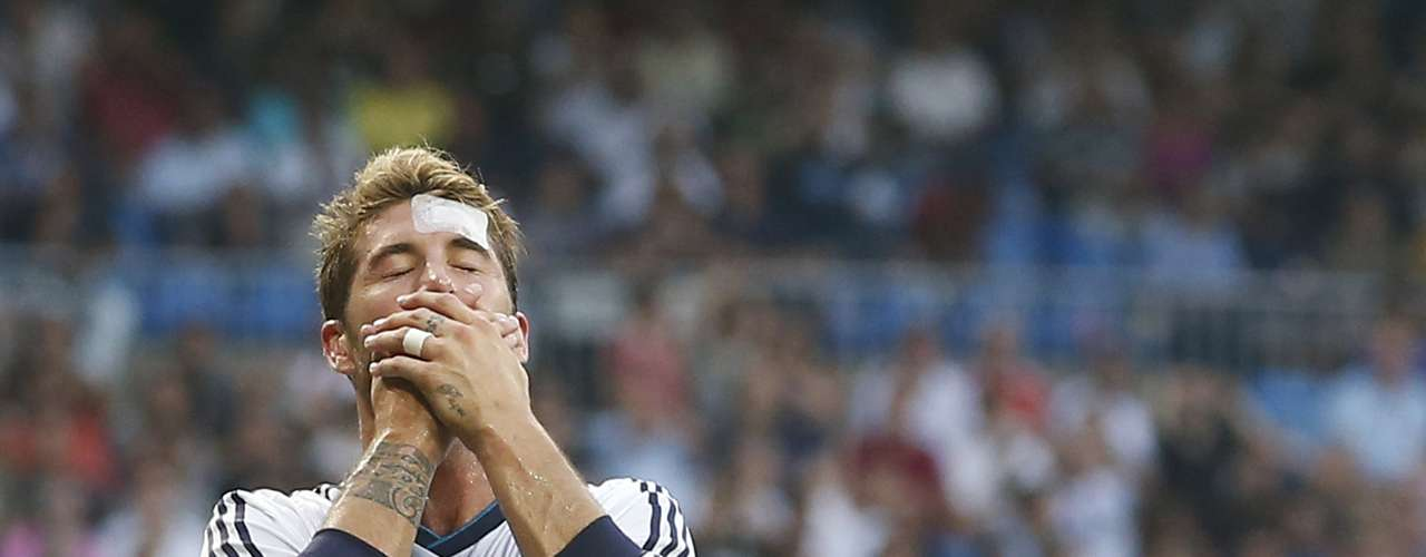 Real Madrid's Sergio Ramos reacts during their Spanish first division soccer match against Valencia at the Santiago Bernabeu stadium in Madrid August 19, 2012. REUTERS/Juan Medina (SPAIN - Tags: SPORT SOCCER)