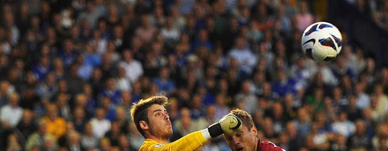 David de Gea of Manchester United punches clear under pressure from Phil Jagielka of Everton during the Barclays Premier League match between Everton and Manchester United at Goodison Park on August 20, 2012 in Liverpool, England.