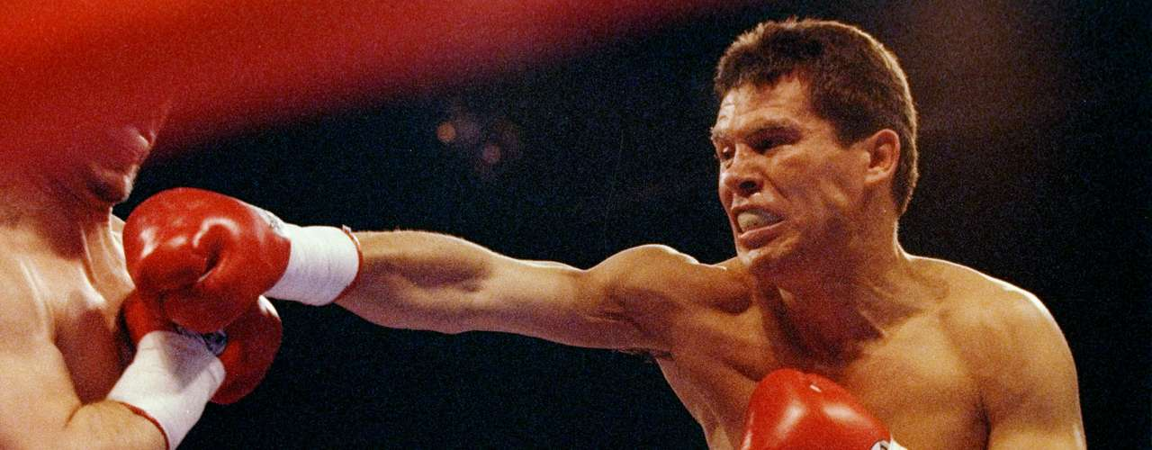 Julio Caesar Chavez throws a punch at Greg Haugen during a fight at Azteca Stadium in Las Vegas, Nevada, in 1993. Chavez won the fight. Chavez was a boxing legend for his warrior mentality, and now his son, Julio Chavez, Jr., has picked up the mantle.