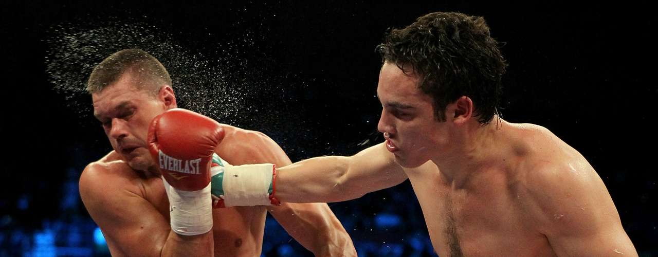 Julio Cesar Chavez Jr. of Mexico connects with a right to the face of Troy Rowland during their middleweight fight at the MGM Grand Garden Arena on November 14, 2009 in Las Vegas, Nevada.