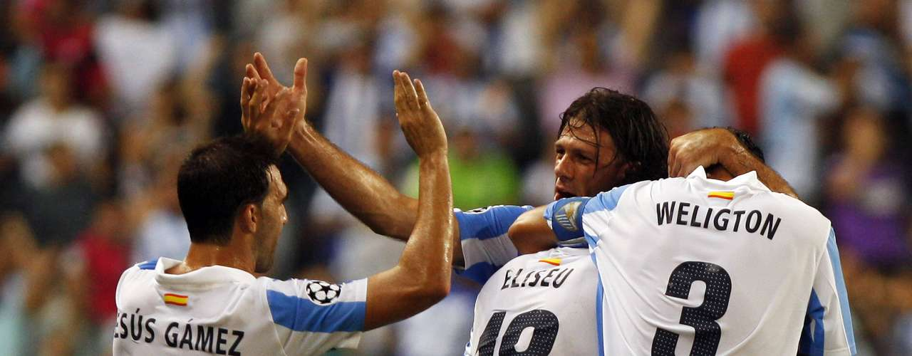 Malaga's Eliseu (2nd L) celebrates with teammates Jesus Gamez (L), Martin Demichellis and Weligton Robson (R) after the first goal. REUTERS/Jon Nazca