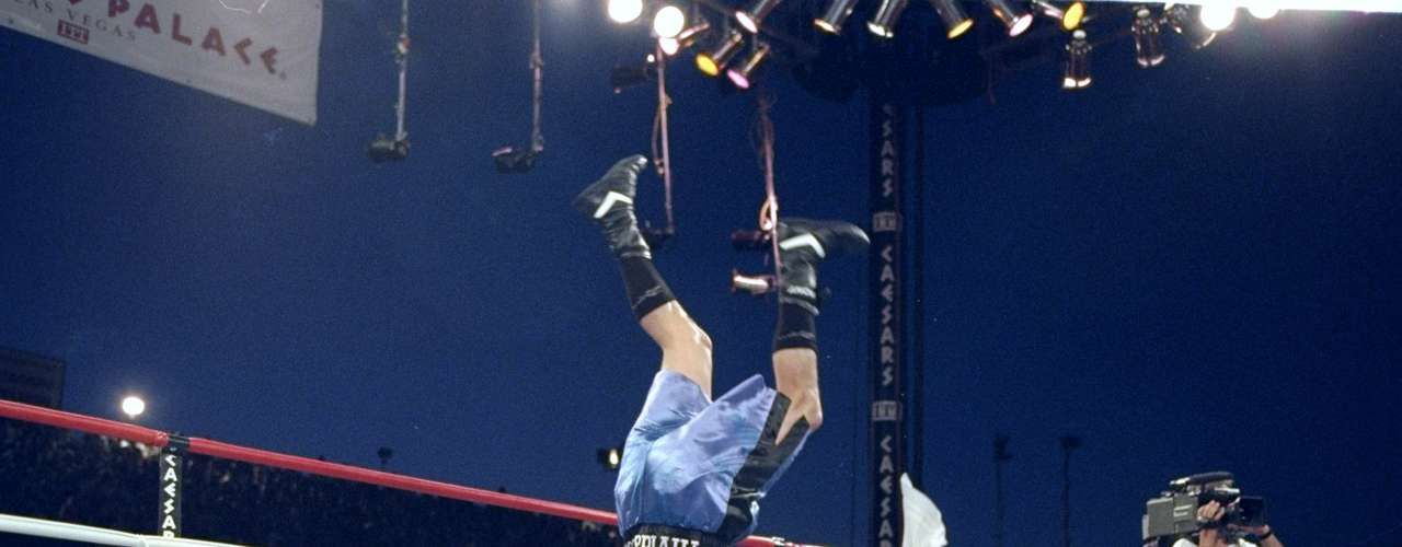 When he returned to the ring in 1994, Tapia immediately won the WBO junior bantamweight title over Henry Martinez.  In this photo, he does a somersault prior to his fight against Ivan Alvarez in which he defended his title.