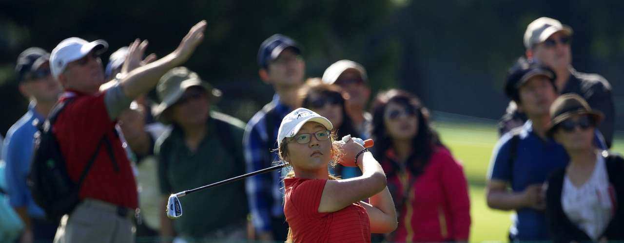 Lydia Ko of New Zealand hits on the first fairway during the final round of the LPGA Canadian Women's Open golf tournament in Coquitlam, British Columbia August 26, 2012.  REUTERS/Andy Clark  (CANADA - Tags: SPORT GOLF)