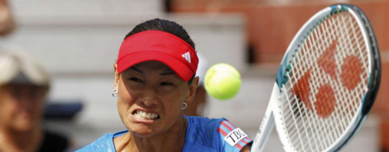 Kimiko Date-Krumm of Japan hits a return to Sofia Arvidsson of Sweden during their women's singles match at the U.S. Open tennis tournament in New York August 28, 2012. REUTERS/Eduardo Munoz (UNITED STATES  - Tags: SPORT TENNIS)