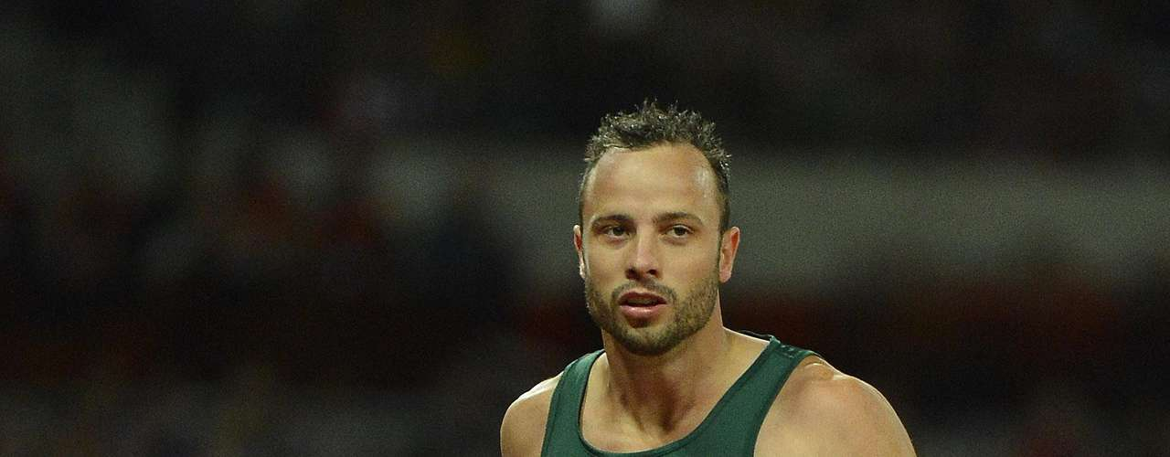 Oscar Pistorius of South Africa wins his men's 200m T44 classification heat in a new world record.