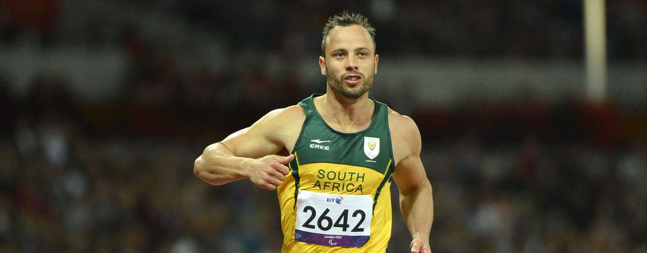 Oscar Pistorius of South Africa wins his men's 200m T44 classification heat in a new world record time.