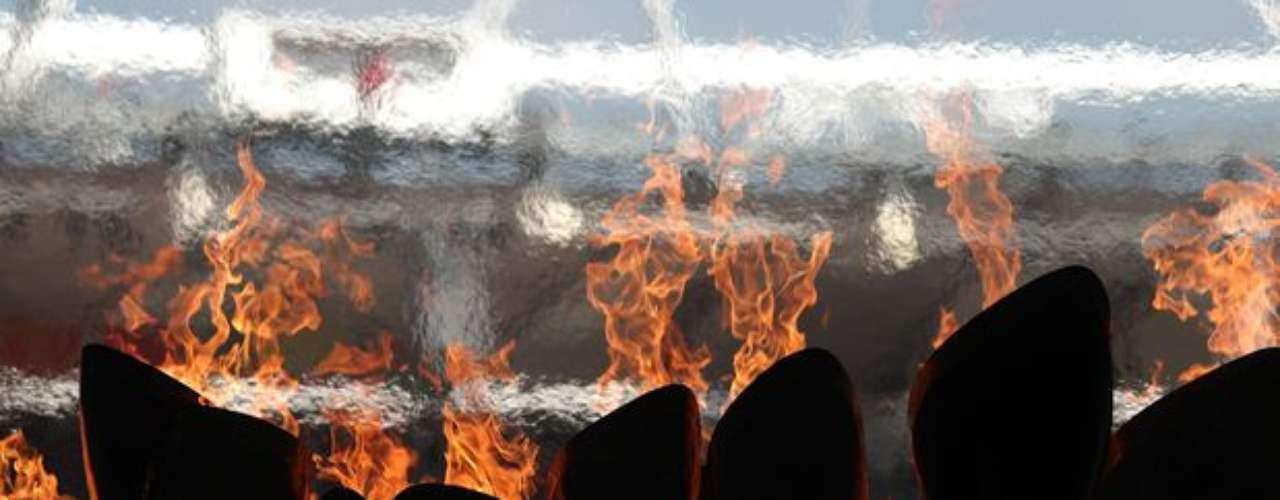El fuego paralímpico da un aire especial a otro día del atletismo en el Estadio Olímpico de Londres.