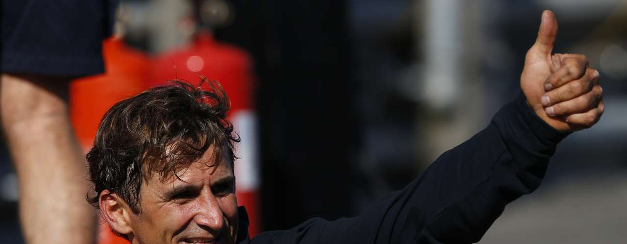 Former Formula One and Cart racing car driver Alessandro Zanardi of Italy, celebrates after winning the Men's Individual H4 Time Trial.