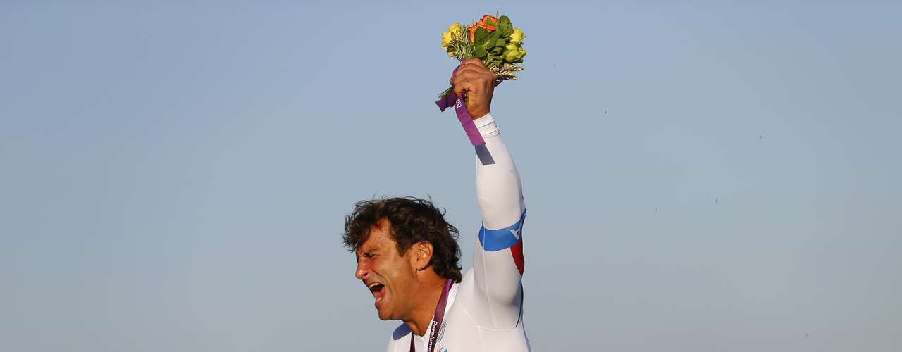 Former F1 and Cart racing car driver Alessandro Zanardi of Italy, celebrates after receiving his gold medal for the Men's Individual H4 Time Trial.