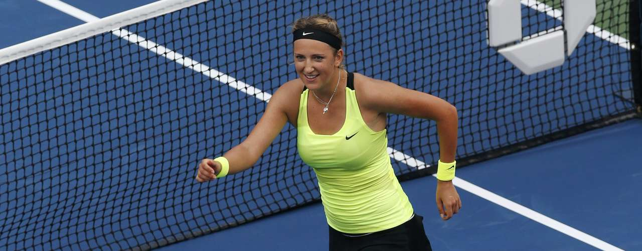 As has been her custom lately, Azarenka dances after making her first ever US Open final. REUTERS/Mike Segar