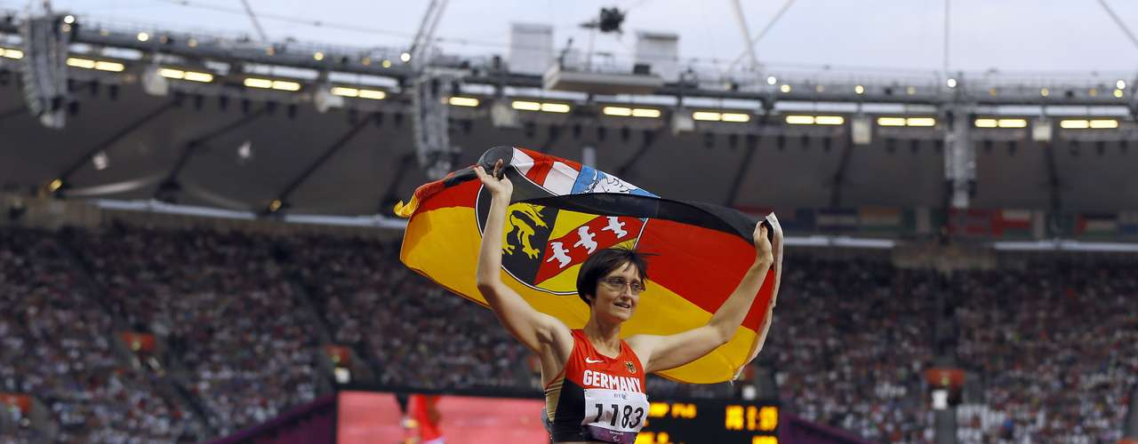 Claudia Nicoleitzik of Germany celebrates winning bronze in the 100-meter final in the T36 category at the Olympic stadium.