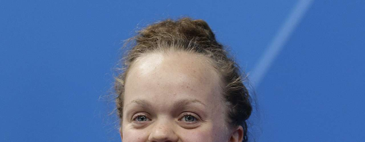 Ellie Simmonds, of Great Britain, holds her gold medal during the ceremony for the 100-meter sprint S6 category.