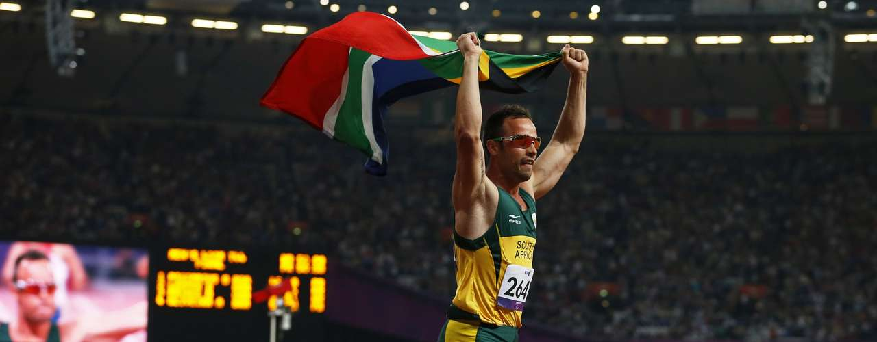 Oscar Pistorius of South Africa celebrates his first individual gold medal of the games.