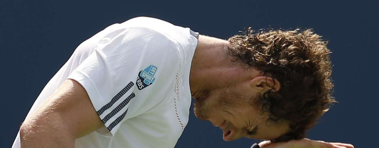 Andy Murray of Britain slaps his head after missing a point against Tomas Berdych.
