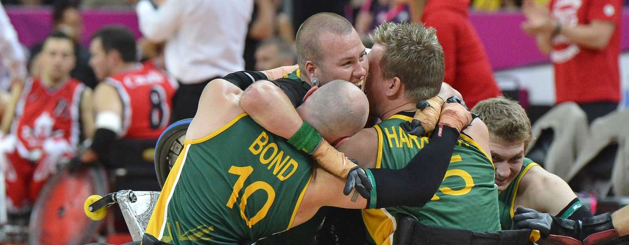 Ryley Batt of Australia (C) celebrates with teammates Chris Bond (L) and Andrew Harrison (R) after winning the Wheelchair Rugby final against Canada at the London 2012 Paralympic Games September 9, 2012. REUTERS/Toby Melville (BRITAIN - Tags: SPORT OLYMPICS RUGBY)