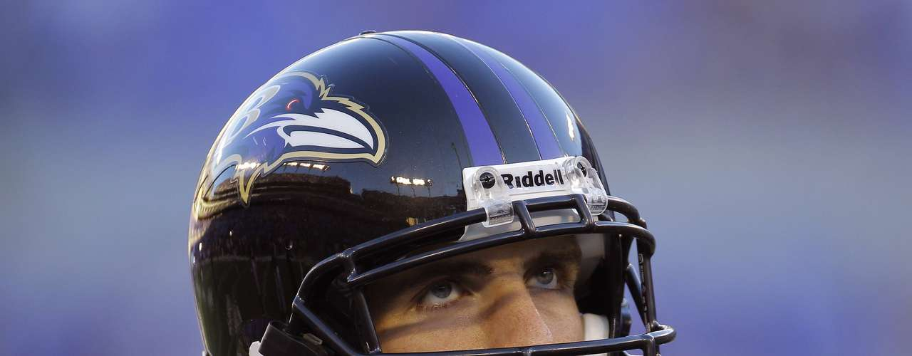 Baltimore Ravens starting quarterback Joe Flacco looks up at the stadium scoreboard before his NFL football home opening football game against the Cincinnati Bengals in Baltimore September 10, 2012.