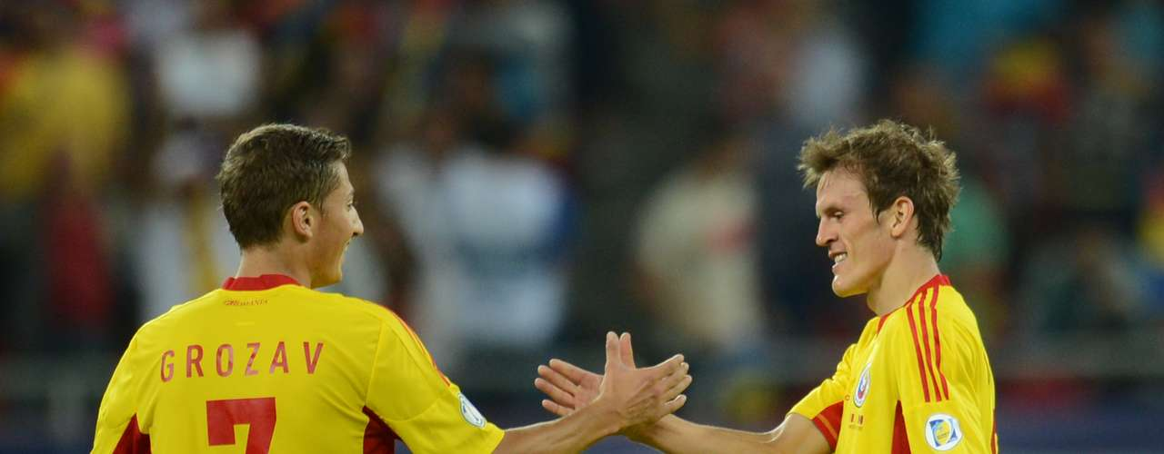 Costin Lazar (right) led Romania to a 4-0 over Andorra after scoring two goals.