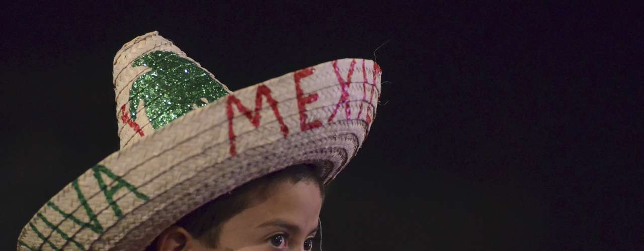 A child wearing a traditional sombrero takes part in an event at Zocalo Square as Mexico marks the 202nd anniversary of the day rebel priest Manuel Hidalgo set it on the path to independence in Morelia September 15, 2012.
