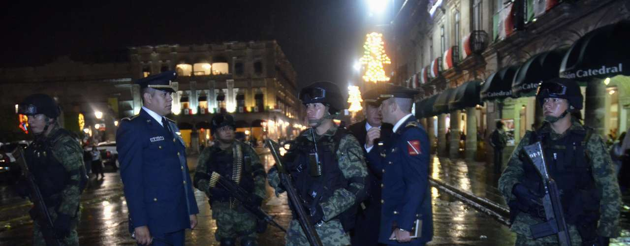 Soldiers stand guard next to Zocalo Square as Mexico marks the 202nd anniversary of the day rebel priest Manuel Hidalgo set it on the path to independence in Morelia September 15, 2012.