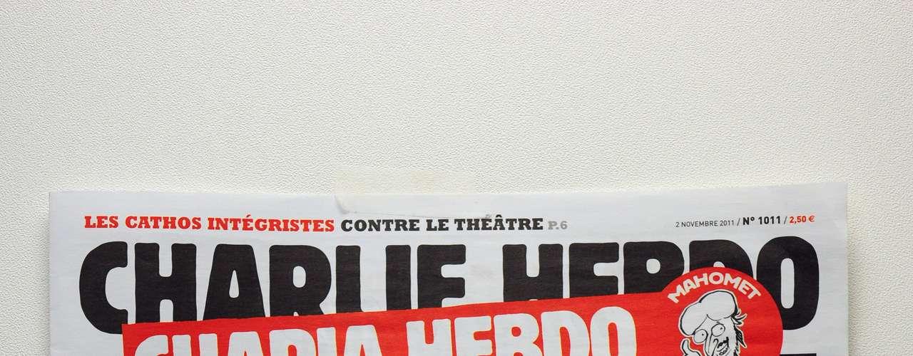 La policía anti disturbios se desplegó para proteger las oficinas en París del semanario Charlie Hebdo, luego de que su nueva edición mostrara una portada en la que aparecía un judío ortodoxo que empujaba a una figura ataviada con un turbante y sentada en una silla de ruedas.
