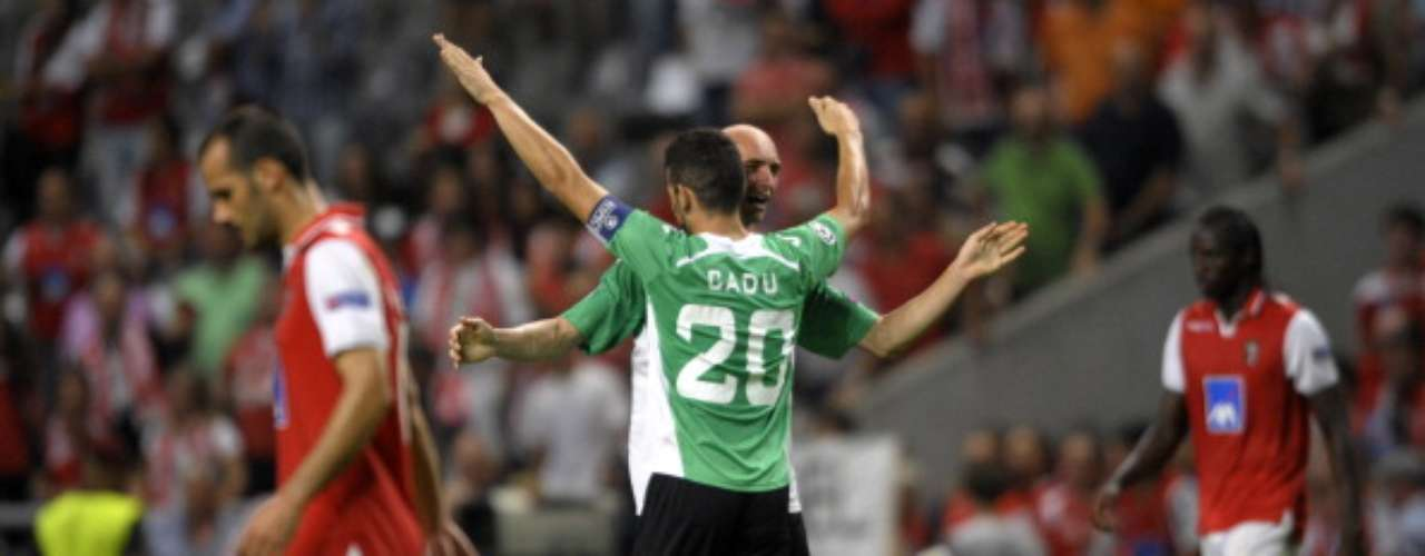 Cadu and Gabriel Muresan celebrate CFU Cluj's vital win in Braga. Rafael Bastos scored in the 19th and 34th minutes.