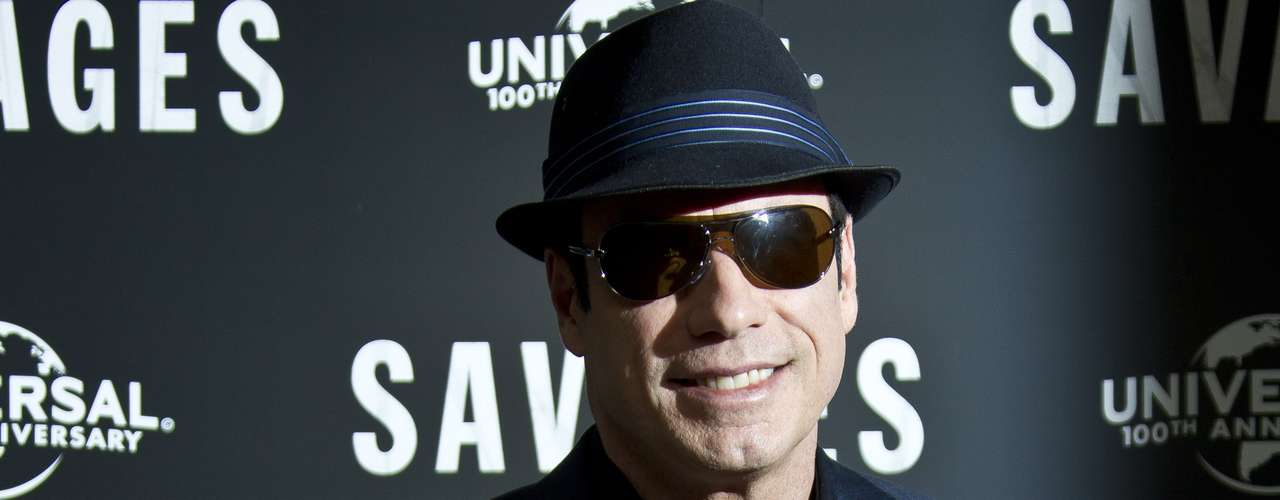 The flashes seemed to bother John Travolta as he wore his shades when posing for the camera.