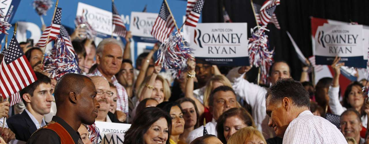 U.S. Republican presidential nominee and former Massachusetts Governor Mitt Romney (R) greets supporters at a campaign rally in Miami, Florida, September 19, 2012. REUTERS/Jim Young (UNITED STATES - Tags: POLITICS ELECTIONS)