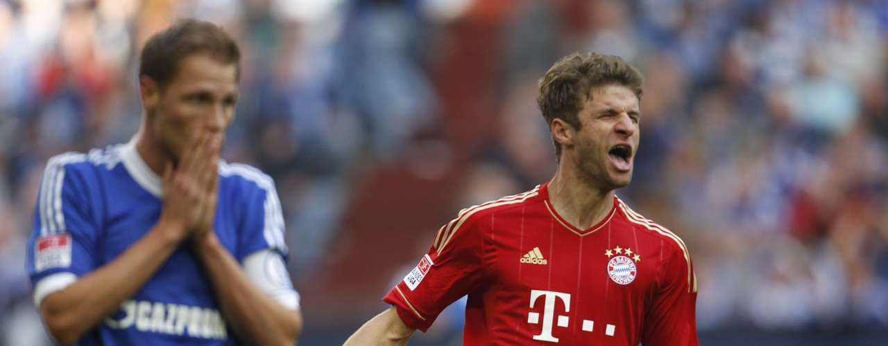 Bayern Munich's Thomas Mueller celebrates a goal against Schalke 04 .