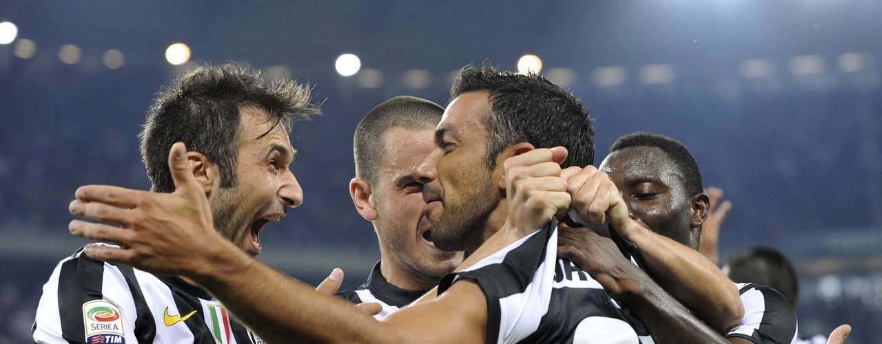 Teammates mob Quagliarella after one of his strikes. REUTERS/Giorgio Perottino