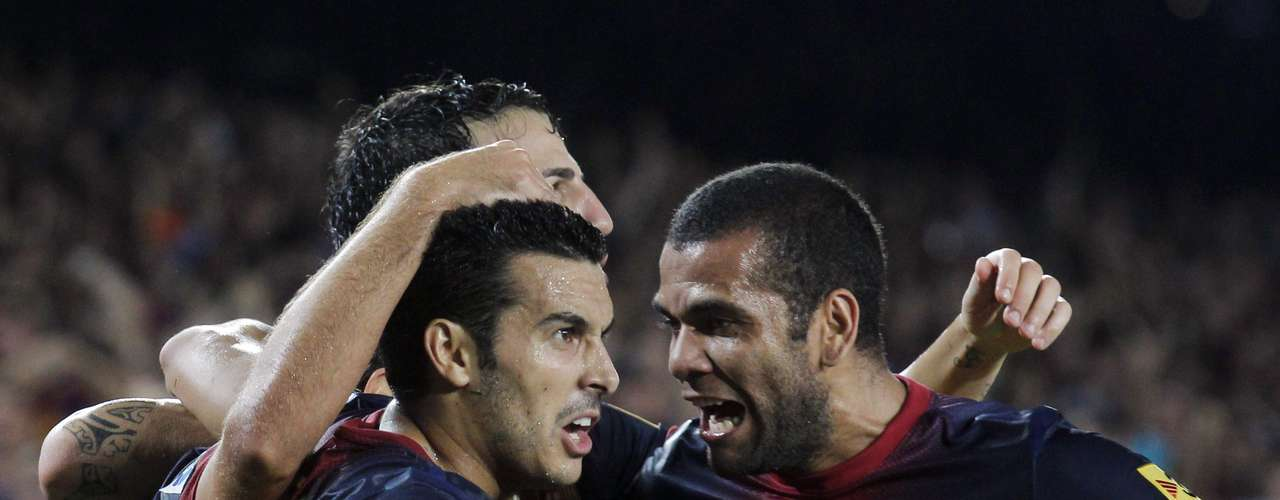 Barcelona's Pedro Rodriguez (L) and Dani Alves celebrate after finally breaking the deadlock.   REUTERS/Albert Gea