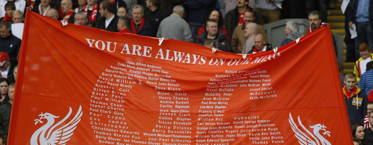 Supporters hold up a banner in memory of victims of the Hillsborough disaster.