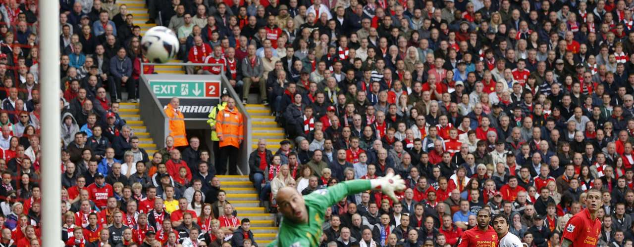 Manchester United's Rafael (2nd R) watches Liverpool's goalkeeper Pepe Reina fail to save his shot.